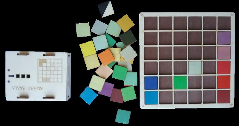 Mācību palīglīdzeklis krāsu apgūšanai. Sastāv no 36 krāsu un to atvasināto toņu kauliņiem, pamatnes to ievietošanai kā arī sešiem klucīšiem, kuru 36 skaldnes nokrāsotas atbilstošās krāsās.