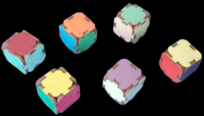 Mācību palīglīdzeklis krāsu apgūšanai. 6 klucīšu 36 skaldnes nokrāsotas 36 krāsu un no tām atvasināto krāsu toņos (atbilstoši krāsu apļa krāsu gammai).