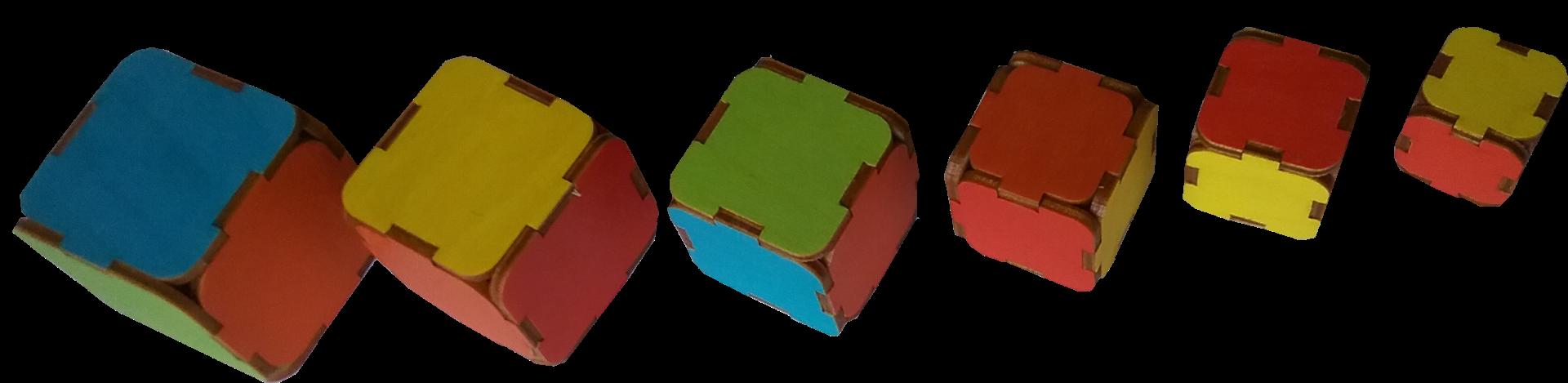 Sešu augoša izmēra, sešu dažādu krāsu kluču komplekts. Klucīšus pakratot ir  dzirdama dažāda augstuma skaņas (sākot ar dobju - zemu skaņu lielākajam līdz augstai, smalkai skaņai).  Iespējami sekojoši veicamie darbi: Grupēšana pēc kluču izmēra, salīdzināšana pēc lieluma.  Sešu dažādu krāsu (zaļš, sarkans, dzeltens, zils, oranžs, violets) iepazīšana un nodarbības ar tām, piemēram,  salikt kluču piramīdu tā lai redzamā mala katram klucim būtu vienādā vai atšķirīgās krāsās.  Fonemātiskās dzirdes attīstīšanas uzdevumi, piemēram, pēc dzirdes noteikt kluču skaņas augstumu, salīdzināt to un sagrupēt klučus pēc izmēra atbilstoši to skanējumam.